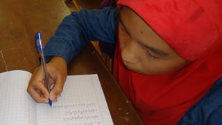 Cham Language Being Written by Student
