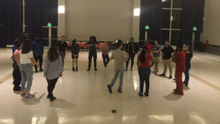 Photo of students salsa dancing
