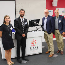 Kathryn Habecker M.P.A. '19, Timothy Hoffman '15/M.P.A. '16, Professor Matthew Hale, Professor Michael Taylor, and Professor Roseanne Mirabella standing together next to a podium