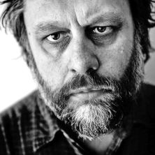 Black and white photo of Slavoj Žižek