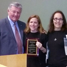 Lisa DeLuca (middle) receives her award from Patrick Brannigan, NJ ASPA president, and Roseanne Mirabella.