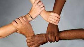 Hands of different races joining together
