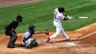 Photo of a baseball player swinging a bat