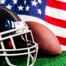 An image of an American flag, a football and a helmet.