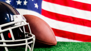An image of a football helmet, a football and an American flag.