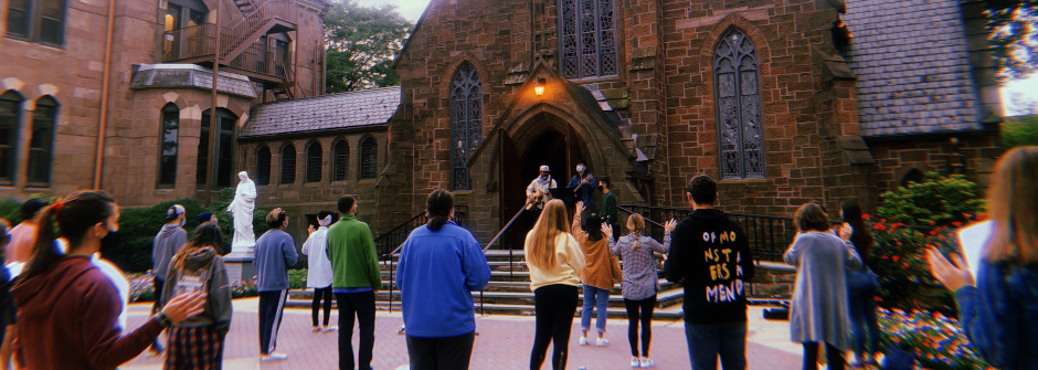 Students standing outside the chapel.