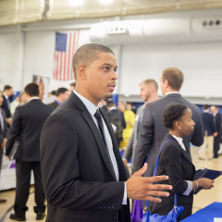 A student networking at the Career Fair.