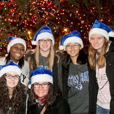 Students in front of the Christmas Tree.