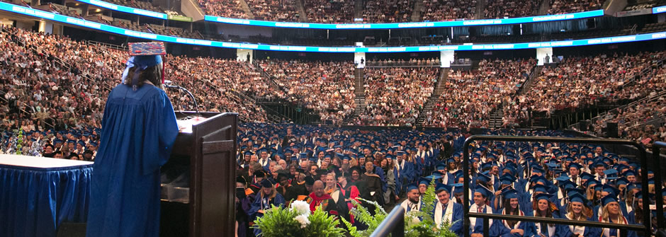 Commencing Student in Speaking in Front of graduates and families at the Prudential Center.
