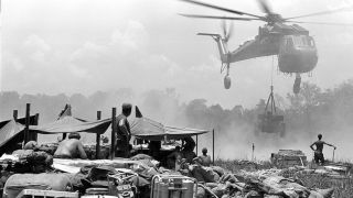 professor honors vietnam war with photo essay   seton hall university black and white photo of a helicopter in vietnam during the war