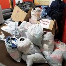 Many bags and boxes filled with the clothes donated to the clothing drive inside the WSOU 89.5 FM studio.