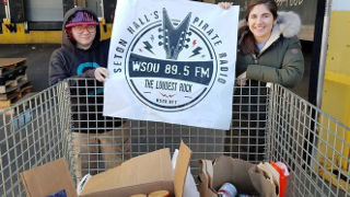 WSOU staff member Katherine Rossi and News Director Jocelyn Rogalo with some of the more than 350 pounds of food Seton Hall University's student-run radio station collected during the station's annual food drive for the Community Foodbank of New Jersey.