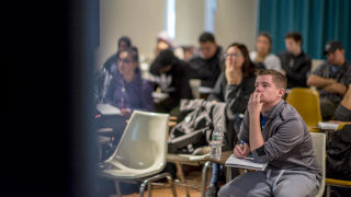 Students watch a presentation in a classroom