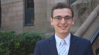 Diplomacy student Jacob Abel in front of President's Hall.