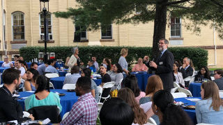 Photo of Dean Bartoli speaking to a crowd of students