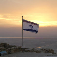 Photo of the Israeli flag in the sunset