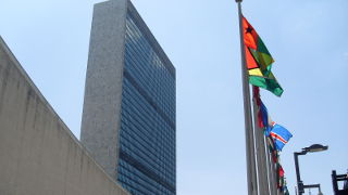 The United Nations Building in New York City, with flags out front.