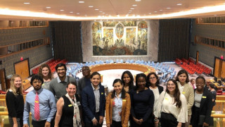 Students who attended the PPIA conference standing in the Security Council Room at the UN.