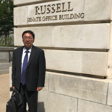 Prof. Huang standing in front of Senate Office Building