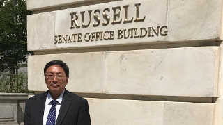 Prof. Huang in front of Senate Office Building