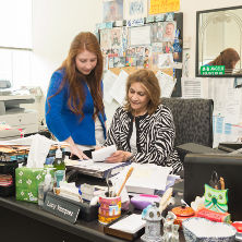 A student in the master's counseling program meeting with a professor.