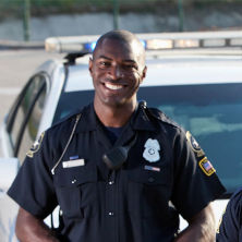 Police Officer smiling in uniform