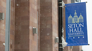 Seton Hall Sign on Campus in the Winter 320
