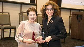 Dean Yates accepting Patricia Kuchon's award from Dr. Boroff