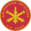 The Air Defense Artillery seal is a red circle with golden missiles crossed in the center.