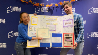 Anne Pino (left) and Andrew D' Amato (right) smile and pose with their winning demo.