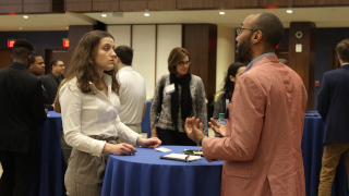 Student mentee and alumni mentor networking at the kick-off CHAMP event.