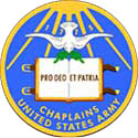 The Chaplain Corps seal is blue and gold with rays of sunlight shining down on a book in the center.