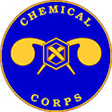 The Chemical Corps seal is a blue circle with a hexagon in the center.