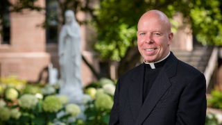 Father Colin Kay on campus.