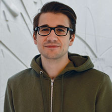 Headshot of psychology student, Grigoriy Shekhtman.