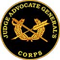 The JAG Corps seal is a black seal with a golden arrow crossed with a staff, surrounded by wings.