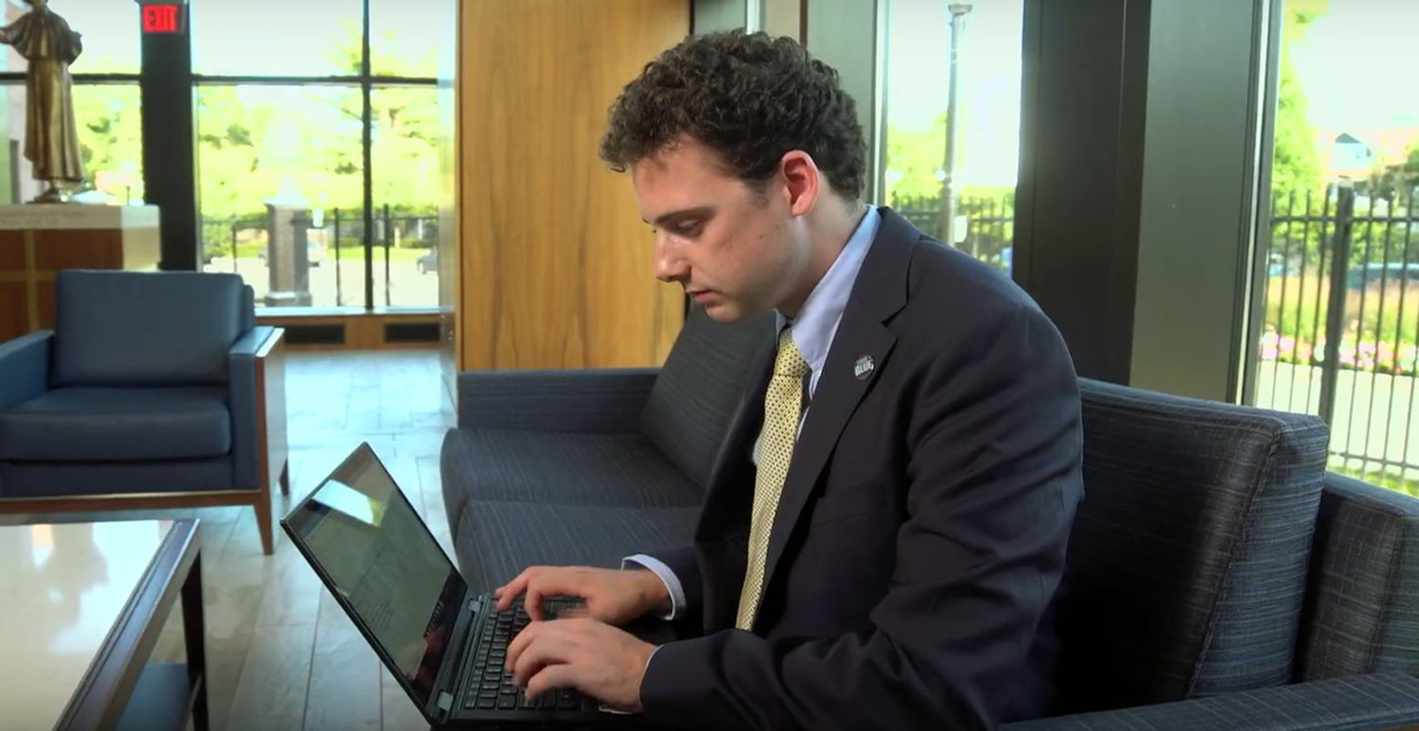 Diplomacy student Matthew Minor working on his laptop in Bethany Hall.