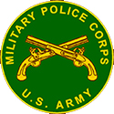 The Military Police Corps logo is a green circle with two golden pistols crossed in the center.