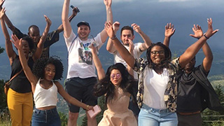 Group photo of Seton Hall students jumping x320