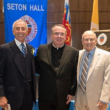 Robert S. Basso '67, Rev. Paul A. Holmes '77 and Nicholas R. Scalera '63 at the dedication of Bethany Hall in June. Basso, Father Holmes and Scalera are brothers in Phi Kappa Theta National Fraternity. x222