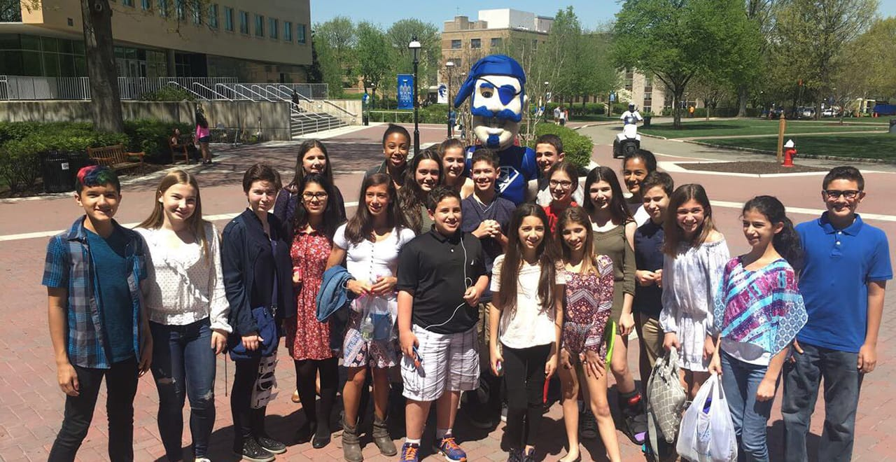 Project Citizen photo of Middle school children outside with the Seton Hall Pirate