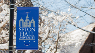 Seton Hall University Banner in snow