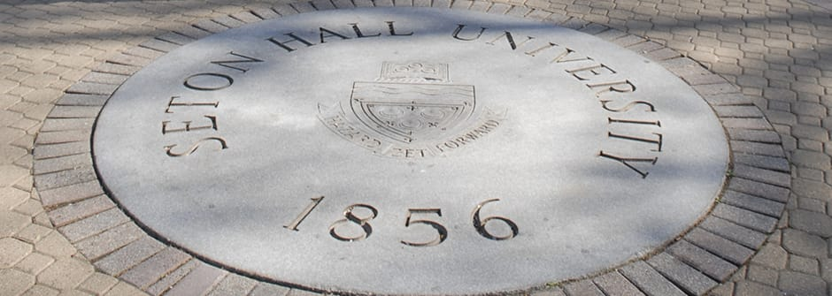 An image of the seal on the University Green.