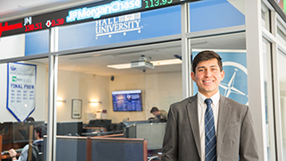 A Stillman student standing by the Trading Room