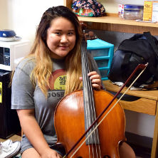 Incoming freshman, Victoria Ling playing her cello on Move-in-Day.