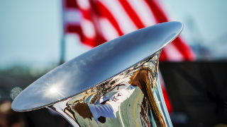 A trumpet in front of an American flag.