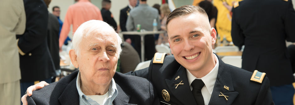 Cadet and Grandfather at the ROTC Commissioning Ceremony.