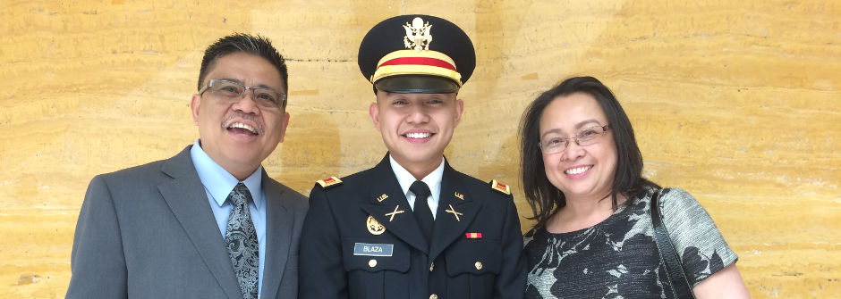 Cadet with parents at the ROTC Commissioning Ceremony.