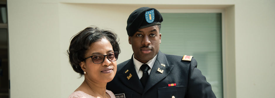 Cadet with mom at ROTC Commissioning Ceremony.