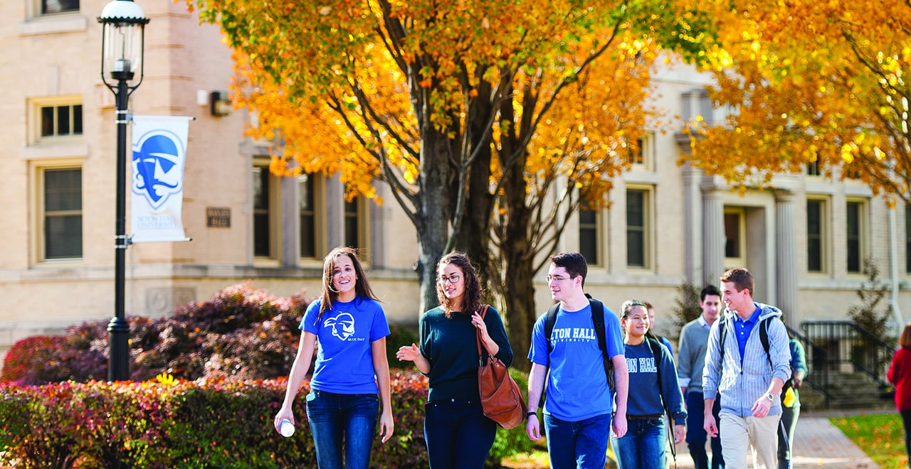 Seton Hall Undergraduate Students Walking on Campus in the Fall